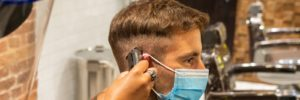 man getting his haircut